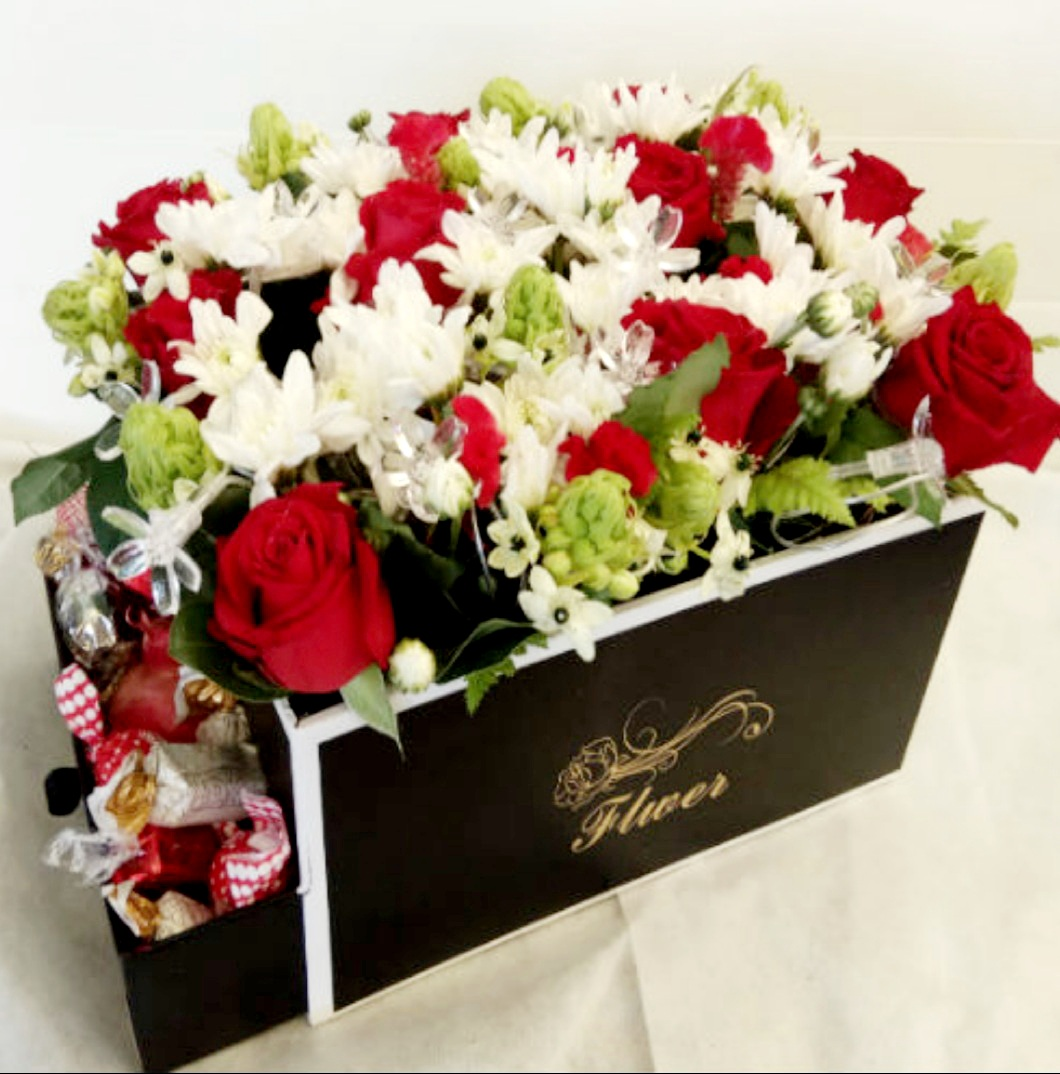 סידור פרחים בקופסא 12